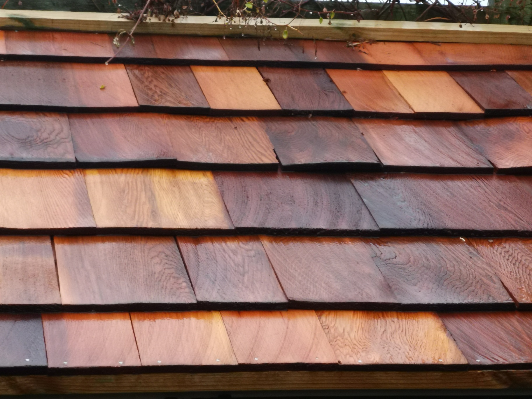 Cedar wood tingles for the roof it should last a few years to say the least,