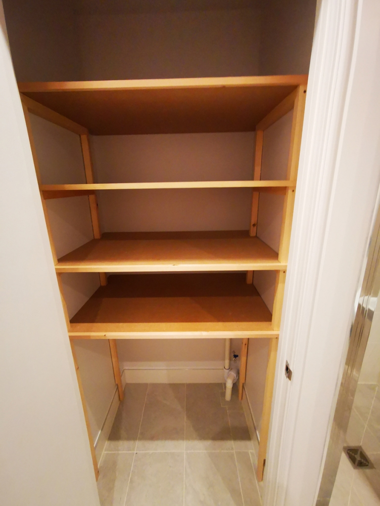 Utility cupboard storage installed by Southampton Carpentry